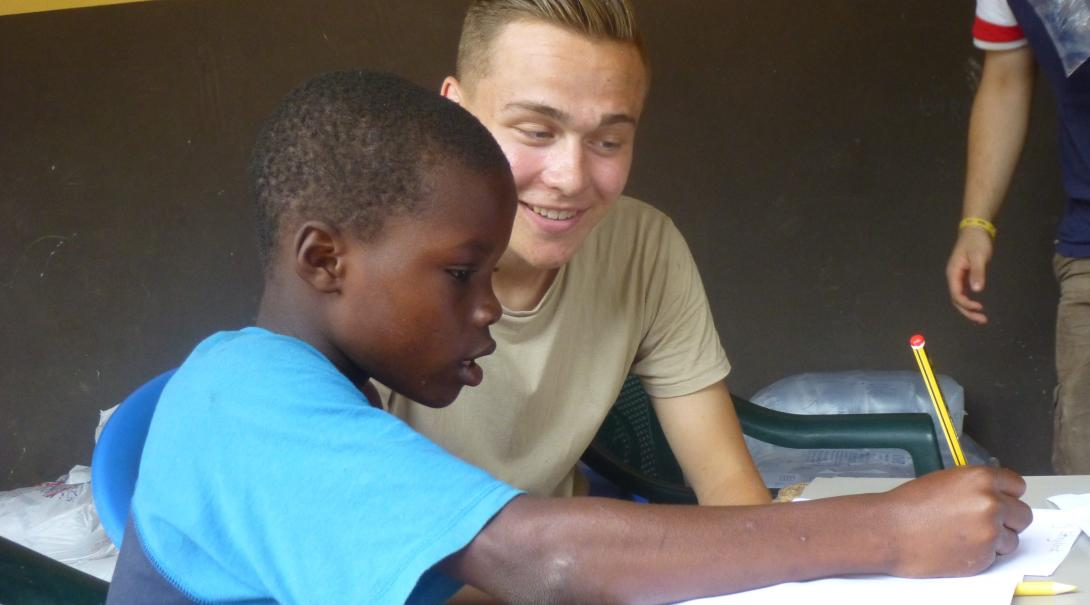 Projects Abroad volunteer helps a child to improve his speech skills through exercises in Ghana while doing his speech therapy internship.